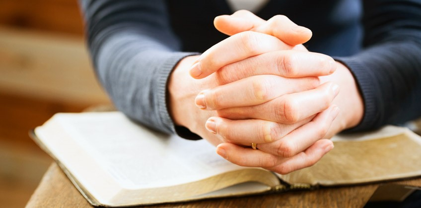 Religious freedom - Praying hands and Bible image